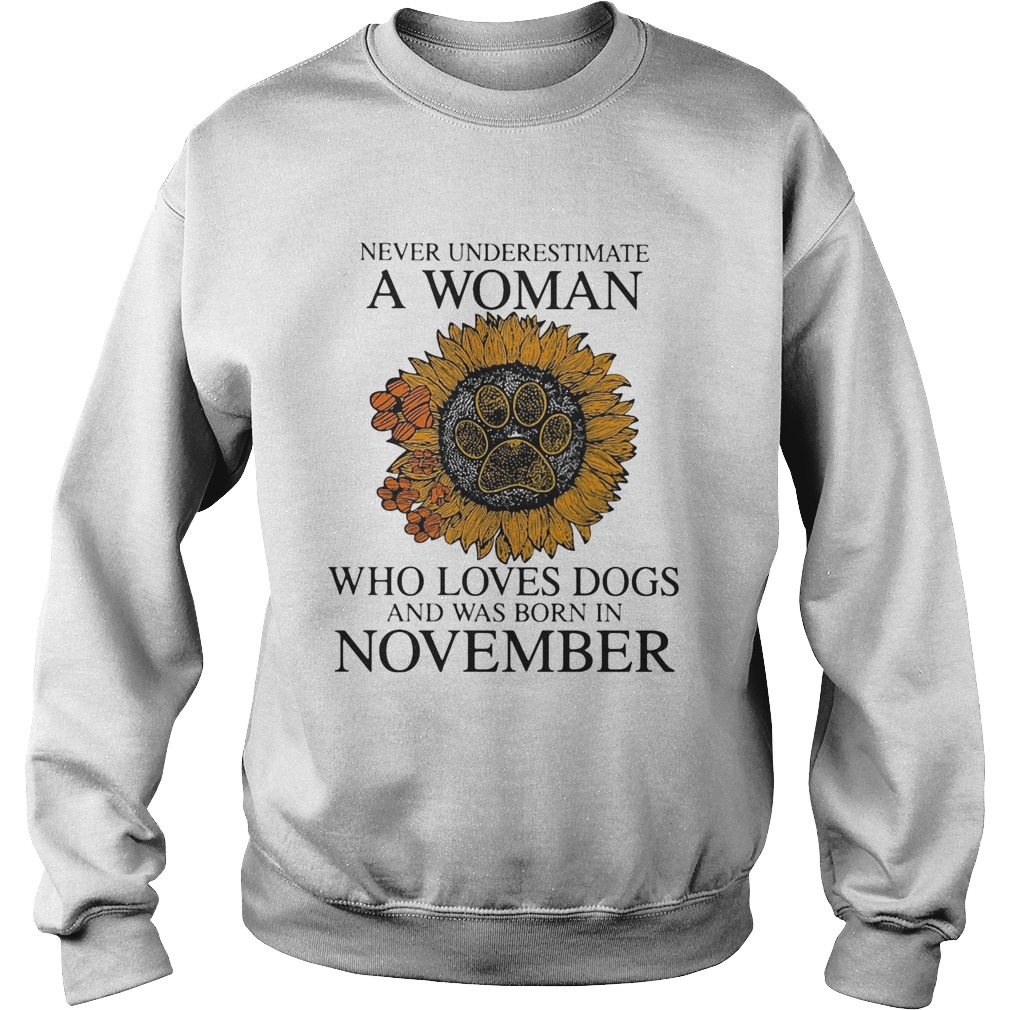 Never underestimate a woman who loves paw dogs and was born in november sunflower  Sweatshirt